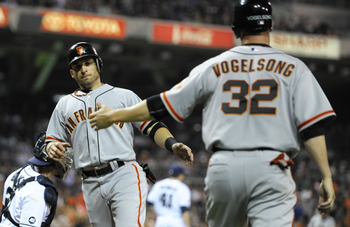 Ryan Vogelsong high-fives Marco Scutaro as he scores on Sept. 28 against the Padres
