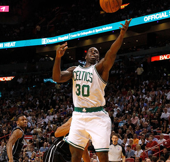 MIAMI, FL - APRIL 10: Brandon Bass #30 of the Boston Celtics loses the ball during a game against the Miami Heat at American Airlines Arena on April 10, 2012 in Miami, Florida. NOTE TO USER: User expressly acknowledges and agrees that, by downloading and/