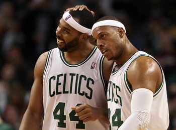 BOSTON, MA - MARCH 02:  Paul Pierce #34 celebrates with teammate Chris Wilcox #44 of the Boston Celtics on March 2, 2012 at TD Garden in Boston, Massachusetts. The Boston Celtics defeated the New Jersey Nets 107-94. NOTE TO USER: User expressly acknowledg