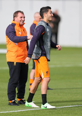 LIVERPOOL, ENGLAND - OCTOBER 03:  Nuri Sahin  of Liverpool with manager Brendan Rodgers during a training session ahead of their UEFA Europa League match against Udinese Calcio at Melwood Training Ground on October 3, 2012 in Liverpool, England.  (Photo b