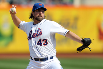 New York pitcher R.A. Dickey edges out third baseman David Wright as the Mets best fantasy player.