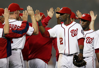 Washinton Nationals players congratulate each other after their win Oct. 2 against the Phillies.