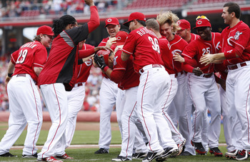 Cincinnati Reds players celebrate their Sept. 27 win against the Milwaukee Brewers.