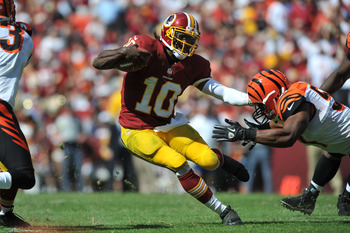 Robert Griffin III splits a hole thanks to blocking from his teammates during the Redskins 2012 home opener