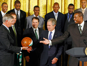 Celtics owners H.Irving Grousbeck ( with ball) and Steve Pagliuca ( center) at the White House with former President George W. Bush in 2008.