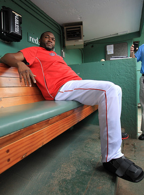 BOSTON, MA - SEPTEMBER 9:   David Ortiz #34 of the Boston Red Sox sits in the dugout with a walking boot on his right foot before a game with the Toronto Blue Jays at Fenway Park on September 9, 2012 in Boston, Massachusetts.  (Photo by Jim Rogash/Getty I