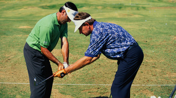 Two great short game artists at work: Seve Ballesteros (left) and Nick Price.