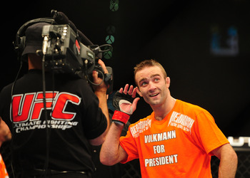 Dec 30, 2011; Las Vegas, NV, USA; UFC fighter Jacob Volkmann celebrates after winning a lightweight bout at UFC 141 at the MGM Grand Garden event center. Mandatory Credit: Mark J. Rebilas-US PRESSWIRE