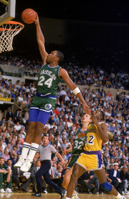 Mark Aguirre goes in for the dunk