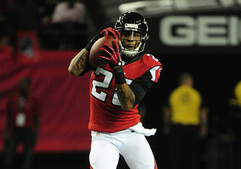Falcons' safety Thomas DeCoud intercepts a pass from Peyton Manning.