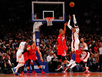 Apr. 25, 2012; New York, NY, USA; New York Knicks small forward Carmelo Anthony (7) shoots over Los Angeles Clippers small forward Caron Butler (5) during the first half at Madison Square Garden. Knicks won 99-93. Mandatory Credit: Debby Wong-US PRESSWIRE