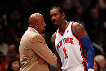 Knicks' Amare Stoudemire talks to Head Coach Mike Woodson in Game 4 of the 2012 NBA playoffs against the Miami Heat.