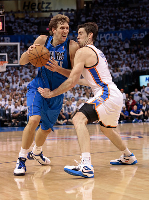 Mavericks' Dirk Nowitzki goes around Nick Collison in Game 1 of Dallas' 2012 playoffs series against the Thunder.