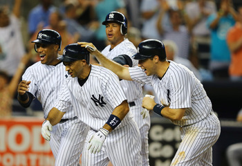 The Yankees celebrate following Raul Ibanez's walkoff hit against the Red Sox Tuesday night