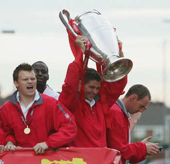 LIVERPOOL, ENGLAND - MAY 26:  Steven Gerrard celebrates with the trophy during the homecoming victory parade through the streets of Liverpool on May 26, 2005 in Liverpool, England.  Liverpool defeated AC Milan in a penalty shoot out 3-2 to win the UEFA Ch