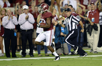 September 29, 2012; Tuscaloosa, AL, USA;  Alabama Crimson Tide wide receiver Christion Jones (22) reruns a kickoff for a touchdown against the Mississippi Rebels during the second quarter at Bryant Denny Stadium. Mandatory Credit: John David Mercer-US PRE