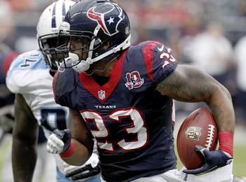 HOUSTON, TX- SEPTEMBER 30: Arian Foster #23 of the Houston Texans rushes against the Tennessee Titans on September 30, 2012 at Reliant Stadium in Houston, Texas. Houston Texans won 38 to 14. (Photo by Thomas B. Shea/Getty Images)