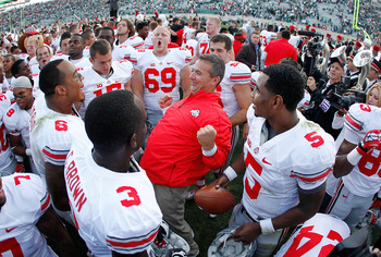 Head coach Urban Meyer leads the celebration of revenge against the Spartans on Sept. 29
