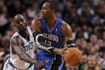 Garnett (left) hopes he has enough left in the tack to compete with Dwight Howard (right)