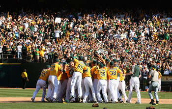 OAKLAND, CA - OCTOBER 03:  The Oakland Athletics celebrate after they beat the Texas Rangers to win the American League West Division Title at O.co Coliseum on October 3, 2012 in Oakland, California.  (Photo by Ezra Shaw/Getty Images)