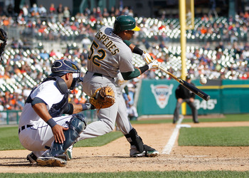 DETROIT, MI - SEPTEMBER 20: Yoenis Cespedes #52 of the Oakland Athletics hits a sixth inning single in front of Gerald Laird #9 of the Detroit Tigersat Comerica Park on September 20, 2012 in Detroit, Michigan. Oakland won the game 12-4. (Photo by Gregory
