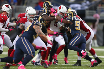 The Rams sacked Kevin Kolb nine times on Thursday.