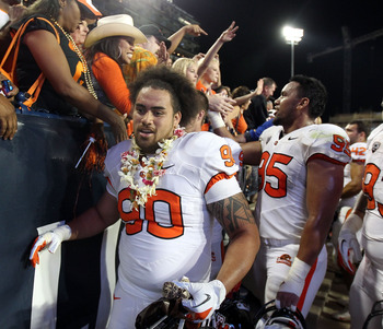 TUCSON, AZ - SEPTEMBER 29:  Defensive end Ali'i Robins #90 of the Oregon State Beavers after the college football game against the Arizona Wildcats at Arizona Stadium on September 29, 2012 in Tucson, Arizona. The Beavers defeated the Wildcats 38-35.  (Pho