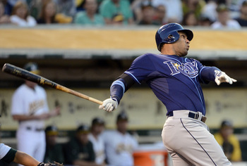 OAKLAND, CA - JULY 30:  Carlos Pena #23 of the Tampa Bay Rays hits a double driving in two runs in the fourth inning against the Oakland Athletics at O.co Coliseum on July 30, 2012 in Oakland, California.  (Photo by Thearon W. Henderson/Getty Images)