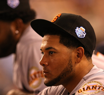 KANSAS CITY, MO - JULY 10:  National League All-Stars Melky Cabrera #53 (L) and Pablo Sandoval #48 of the San Francisco Giants watch from the dugout in the ninth inning during the 83rd MLB All-Star Game at Kauffman Stadium on July 10, 2012 in Kansas City,