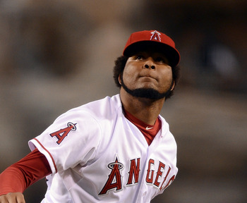 ANAHEIM, CA - SEPTEMBER 12:  Ervin Santana #54 of the Los Angeles Angels watches a pop fly for an out of Coco Crisp #4 of the Oakland Athletics during the first inning at Angel Stadium of Anaheim on September 12, 2012 in Anaheim, California.  (Photo by Ha