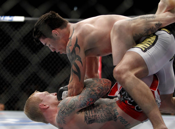 Oct 5, 2012; Minneapolis, MN, USA; Bart Palaszewski (bottom) vs Diego Nunes during their featherwight bout at the UFC on FX 5 at the Target Center. Mandatory Credit: Bruce Kluckhohn-US PRESSWIRE