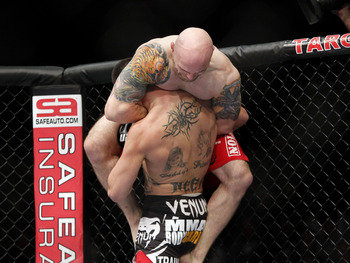 Oct 5, 2012; Minneapolis, MN, USA; Justin Edwards (top) locks in a guillotine choke on Josh Neer during their bout at the UFC on FX 5 at the Target Center. Mandatory Credit: Bruce Kluckhohn-US PRESSWIRE