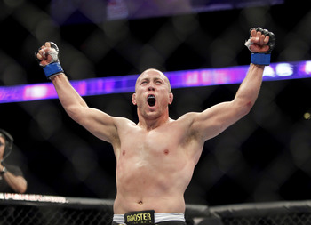 Oct 5, 2012; Minneapolis, MN, USA; Mike Pierce celebrates after knocking out Aaron Simpson (not pictured) during the UFC on FX 5 at the Target Center. Mandatory Credit: Bruce Kluckhohn-US PRESSWIRE