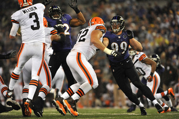 BALTIMORE - SEPTEMBER 27:  Paul Kruger #99 of the Baltimore Ravens defends against the Cleveland Browns at M&T Bank Stadium on September 27, 2012 in Baltimore, Maryland. The Ravens defeated the Browns 23-16. (Photo by Larry French/Getty Images)