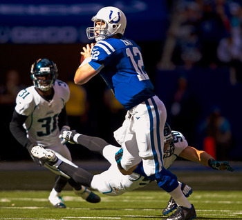 INDIANAPOLIS, IN - SEPTEMBER 23:  Andrew Luck #12 of the Indianapolis Colts looks for an open receiver as Russell Allen #50 of the Jacksonville Jaguars attempts the sack at Lucas Oil Stadium on September 23, 2012 in Indianapolis, Indiana. (Photo by Michae