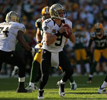 GREEN BAY, WI - SEPTEMBER 30:  Drew Brees #9 of the New Orleans Saints looks for a receiver against the Green Bay Packers at Lambeau Field on September 30, 2012 in Green Bay, Wisconsin. The Packers defeated the Saints 28-27.  (Photo by Jonathan Daniel/Get