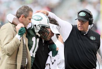 EAST RUTHERFORD, NJ - SEPTEMBER 30:  Head coach Rex Ryan consoles Santonio Holmes #10 of the New York Jets after Holmes is taken off the field in the second half against the San Francisco 49ers on September 30, 2012 at MetLife Stadium in East Rutherford,