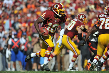 LANDOVER, MD - SEPTEMBER 23: Robert Griffen III #10 of the Washington Redskins runs the ball after making  catch against the Cincinnati Bengals at FedExField on September 23, 2012 in Landover, Maryland. The Bengals defeated the Redskins 38-31. (Photo by L