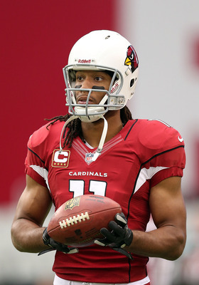GLENDALE, AZ - SEPTEMBER 30:  Wide receiver Larry Fitzgerald #11 of the Arizona Cardinals warms up before the NFL game against the Miami Dolphins at the University of Phoenix Stadium on September 30, 2012 in Glendale, Arizona. The Carindals defeated the D