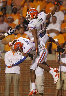 KNOXVILLE, TN - SEPTEMBER 15: Jordan Reed #11 of the Florida Gators celebrates his touchdown catch with Quinton Dunbar #1 during the second half of play against the Tennessee Volunteers at Neyland Stadium on September 15, 2012 in Knoxville, Tennessee.
