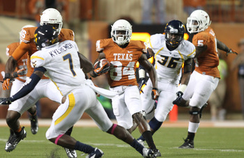 Oct 6, 2012; Austin, TX, USA; Texas Longhorns wide receiver Marquise Goodwin (84) returns a kick during the third quarter against the West Virginia Mountaineers at Darrell K Royal-Texas Memorial Stadium. West Virginia beat Texas 48-45. Mandatory Credit: T
