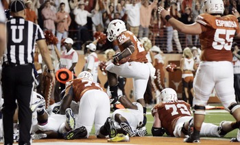 Oct 6, 2012; Austin, TX, USA; Texas Longhorns tailback Joe Bergeron(24) scores a touchdown during the second quarter against the West Virginia Mountaineers at Darrell K Royal-Texas Memorial Stadium. Mandatory Credit: Tim Heitman-US PRESSWIRE