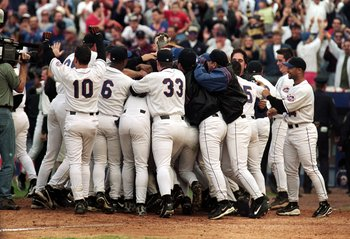 The Mets mobbed Pratt at home plate after his blast.