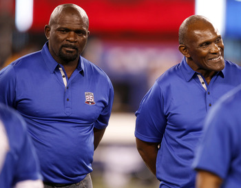 September 19, 2011; East Rutherford, NJ, USA; New York Giants former defensive greats Lawrence Taylor (left) and Harry Carson (right) and the rest of the 1986 super bowl champion Giants are honored at halftime against the St. Louis Rams at MetLife Stadium