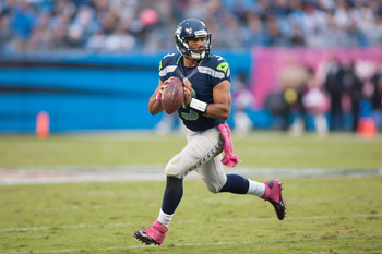 Oct 7, 2012; Charlotte, NC, USA; Seattle Seahawks quarterback Russell Wilson (3) looks for an open receiver during the third quarter against the Carolina Panthers at Bank of America Stadium. The Seahawks defeated the Panthers 16-12. Mandatory Credit: Jere