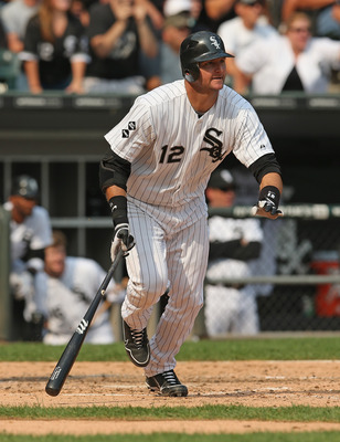 CHICAGO, IL - SEPTEMBER 17:  A.J. Pierzynski #12 of the Chicago White Sox bats against the Detroit Tigers at U.S. Cellular Field on September 17, 2012 in Chicago, Illinois. The White Sox defeated the Tigers 5-4.  (Photo by Jonathan Daniel/Getty Images)