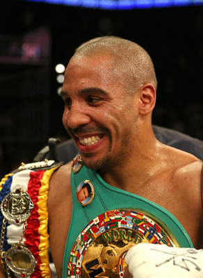 Andre Ward smiles after retaining his unified WBA and WBC titles.