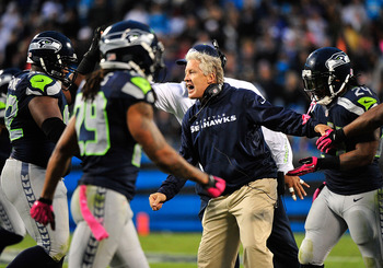 CHARLOTTE, NC - OCTOBER 07:  Coach Pete Carroll of the Seattle Seahawks celebrates with his defense after a goal line stand late in the fourth quarter against the Carolina Panthers at Bank of America Stadium on October 7, 2012 in Charlotte, North Carolina