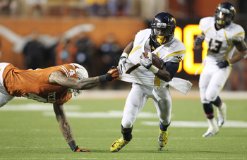 Oct 6, 2012; Austin, TX, USA; West Virginia Mountaineers wide receiver Tavon Austin (1) is tackled by Texas Longhorns safety Kenny Vaccaro (4) during the game at Darrell K Royal-Texas Memorial Stadium. West Virginia beat Texas 48-45. Mandatory Credit: Tim