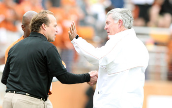 Oct 6, 2012; Austin, TX, USA; West Virginia Mountaineers head coach  Dana Holgorsen (L) talks to Texas Longhorn head coach Mack Brown before the game at Darrell K Royal-Texas Memorial Stadium. Mandatory Credit: Tim Heitman-US PRESSWIRE